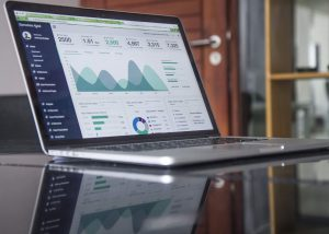 Key Business Metrics- Laptop with charts & metrics on the screen